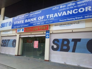 Central Government Approves Sbi Sbt Merger