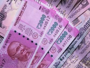 Rupee Edges Higher Against Us Dollar
